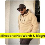 Amit Bhadana standing infront of a wall with sunglasses on   Amit Bhadana Net Worth and Biography
