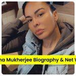 Ayesha Mukherjee sitting on a sofa selfie