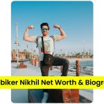 Mumbiker Nikhil standing infront of a city view with a goggle on and flexed hands   Mumbiker Nikhil Net Worth and Biography